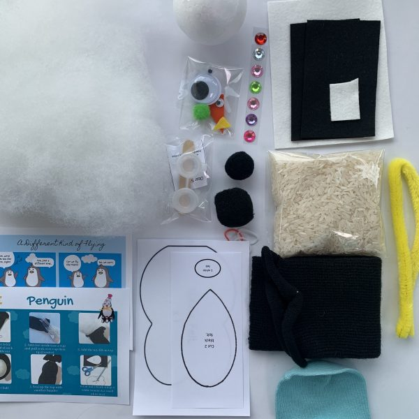 elements for making the penguin including toy fill felt socks pipecleaners