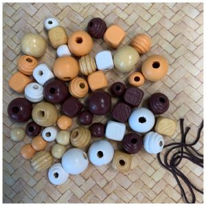 Brown, white natural wooden beads with cord